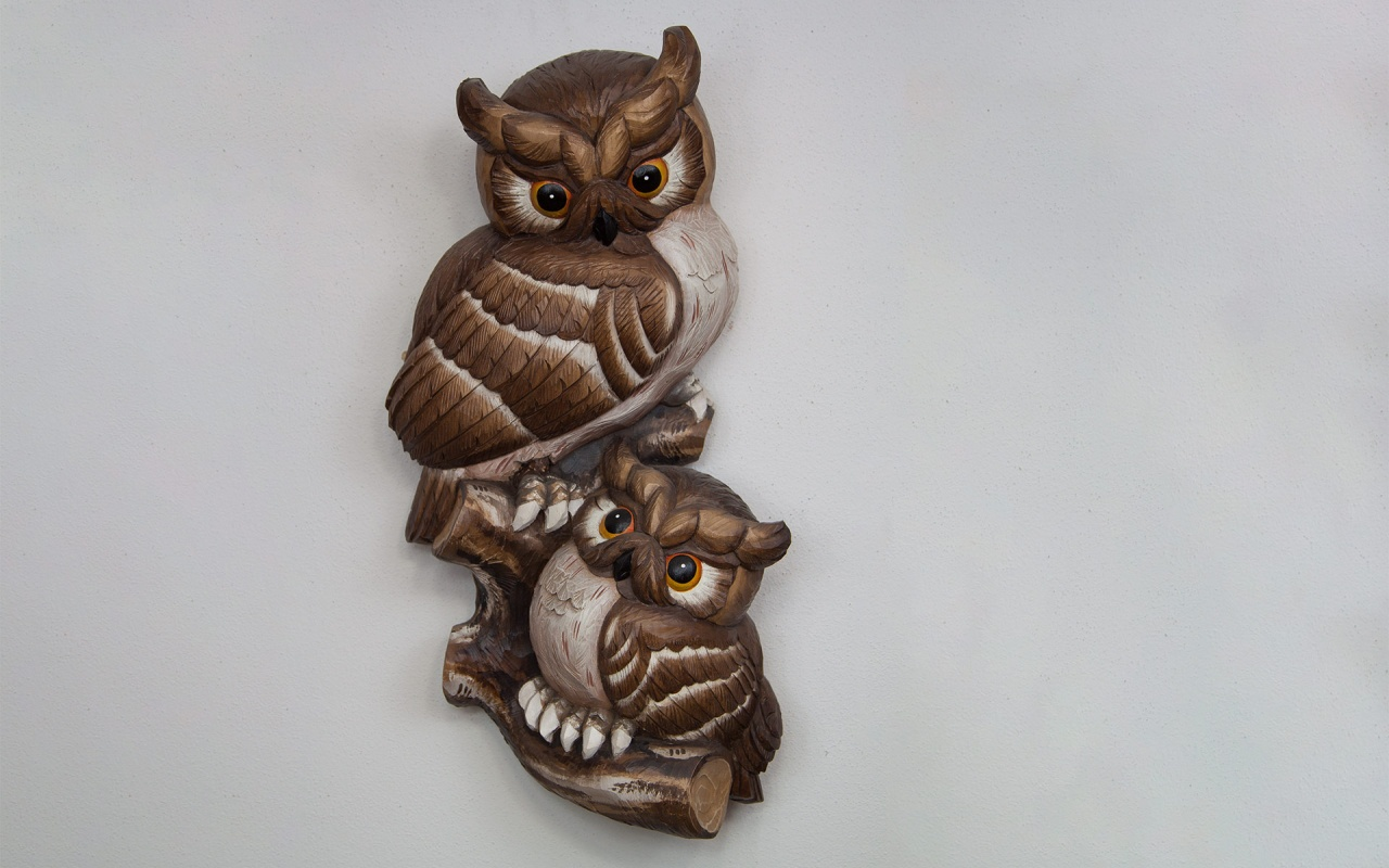 Half relief owl with child